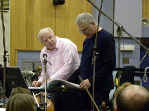 Leonard Slatkin discusses a point with John Corigliano during the recent LMO sessions for Edge Of Darkness.